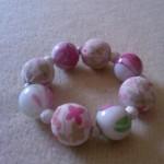 Bracciale boule e fiori
